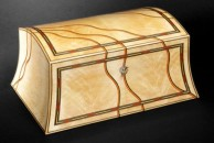 """A curved sided, domed top jewellery box veneered with rare sycamore crotch veneer and decorated with dyed veneers. 15"""" x 11"""" x 8"""", french polished."""