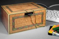 This colourful box was made for a customer after he saw a small watercolour box with similar decoration. The exterior is veneered with Canadian figured maple, decorated with dyed veneers and french polished. This was a project in my second book, 'Fine Decorative Boxes' published by Sterling in 1998.