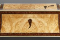 """A double curved jewellery box veneered with burr maple and decorated with wide snakewood lines. 13"""" x 9"""" x 5"""", french polished."""