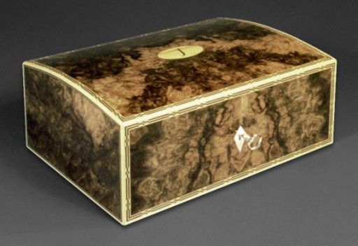 A domed top jewellery box veneered with burr walnut Fine