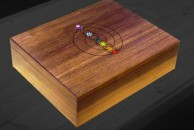 Jewellery box in walnut with a central lid design based on the chakras. Danish oil.