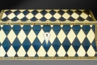 """This double curved jewellery box is decorated all over with a blue and white harlequin design using dyed veneers. 13"""" x 9"""" x 5"""", french polished."""