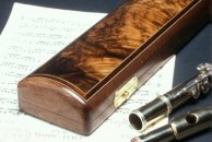 A curved top case in walnut for a Boehm system flute. The lid is veneered with bookmatched burr walnut veneer and the exterior is french polished.
